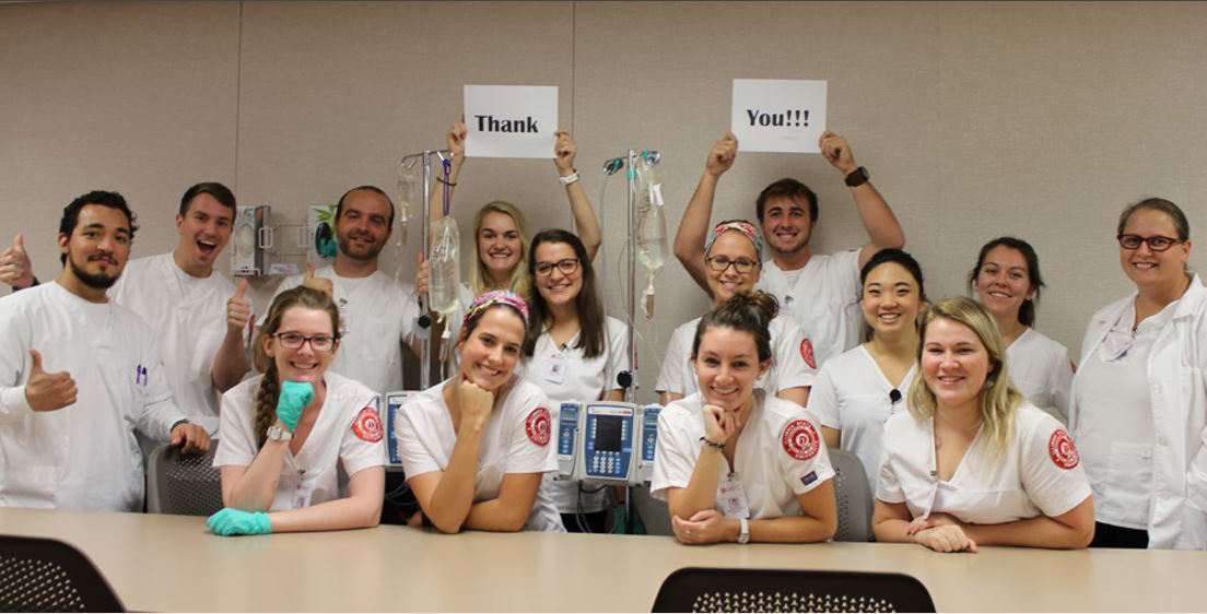 Photo of Mennonite College of Nursing students saying thank you.